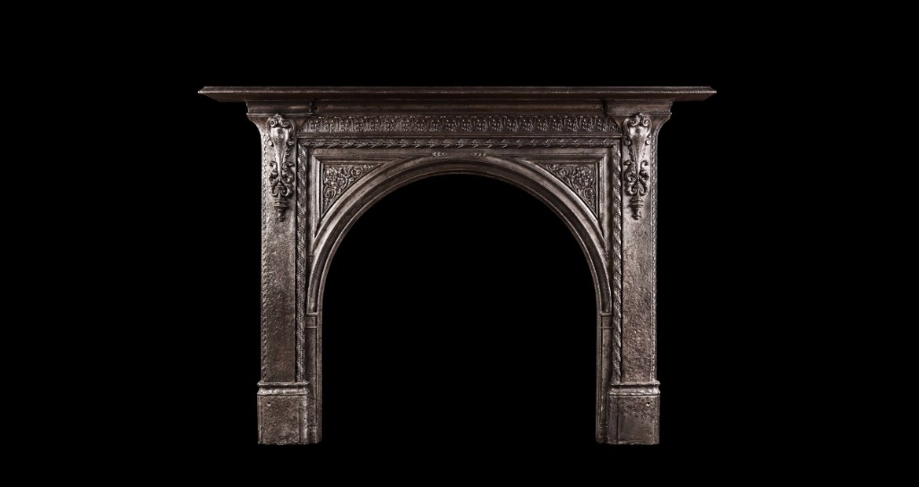 19TH CENTURY IRON FIREPLACE WITH ARCHED OPENING
